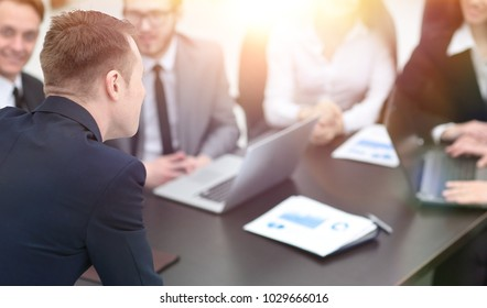 blurred image of business team at a Desk