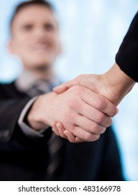 Blurred image of a businessman shaking hands.
