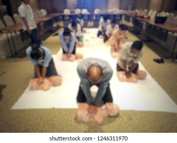 Blurred image of CARDIO-PULMONARY RESUSCITATION or CPR training with emergency procedure on CPR doll.
