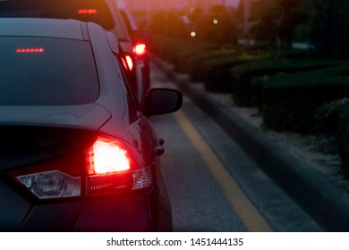 Blurred image of cars on the road with light break at in evening.