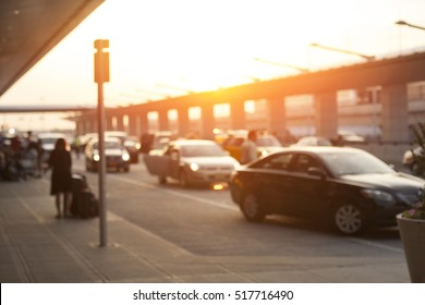 Blurred image of cars waiting in LAX Los Angeles international airport arrivals terminal taxi lane, an uber, taxify or lyft pick up location.