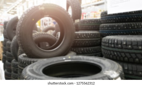 Blurred image close up of car tires for sale. Photo of lots of car tires in the shop for hot sale. Advertisment for car tires