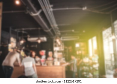 Blurred image of coffee bar, decorated in retro style.