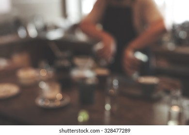 blurred image of coffee counter,vintage filter.