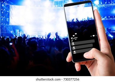 Blurred image of concert Crowd Cheering fans during live music with singer song on stage