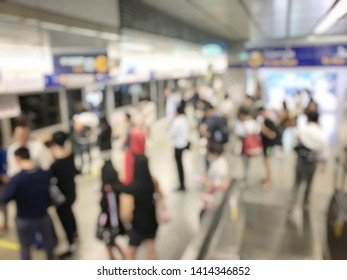blurred image of Crowded station with people and passenger standing, walking and waiting for pick and choose the best public transport during rush hour in Bangkok city.