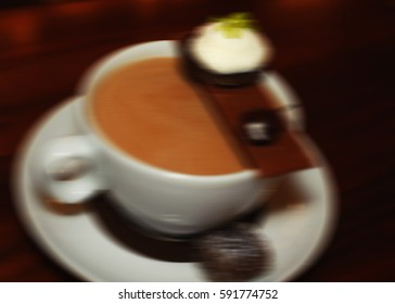 Blurred image of a cup of hot chocolate
