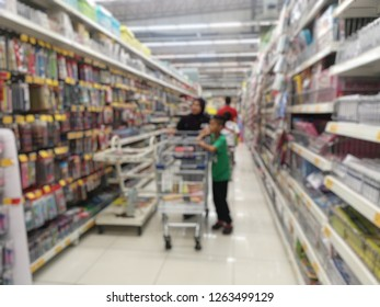 Blurred image: customers are buying school supplies in the stationery department in the supermarket
