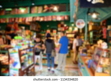 Blurred image of customers in a candy store