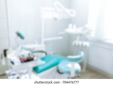 Blurred image of the dentist office, medical background. Dentist cabinet.