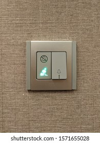 Blurred Image of a Doorbell Switch on the Hotel Wall