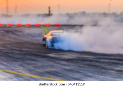 Blurred image of drifting car on track