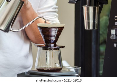 Blurred image of Drip coffee.Barista pour hot water from kettle for make a coffee to customers in a coffee shop.