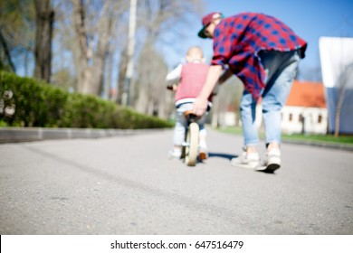 Blurred image of father, son ,