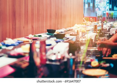 blurred image of Food on the conveyor belt or belt buffet
