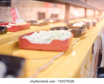 blurred image of Food on the conveyor belt