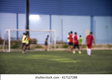 Blurred image of a football field, use for background.