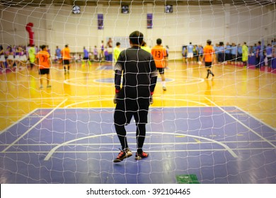 Blurred image of Futsal players in a game