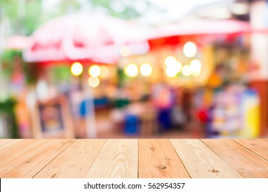 blurred image of grocery shop in the evening with beautiful bokeh from the lights