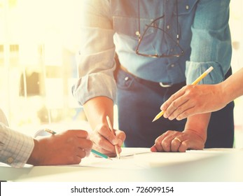 Blurred image, hand of architect and engineer working in office, construction concept and Engineering tools with vintage color tone process for background