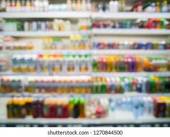 Blurred image of healthy drinking bottles or refreshment beverage products, milk, water drinking, fruit juice, alcoholic beverage on shelves in grocery store or supermarket background