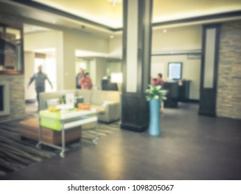 Blurred image a hotel lobby in Texas, America. People walking. Travel, business and holiday vacation concept.
