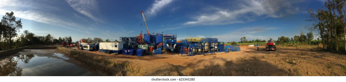 Blurred image of hydraulic fracturing unit with blue sky in panorama