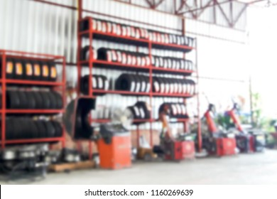 Blurred image inside the tire shop.