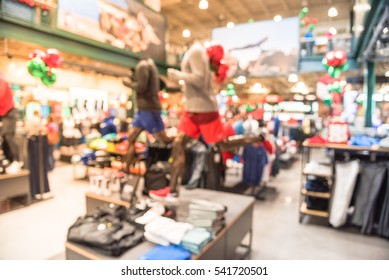 4419b267f8386 Blurred image interior of sports and fitness clothing store in America. Sport  shop with famous