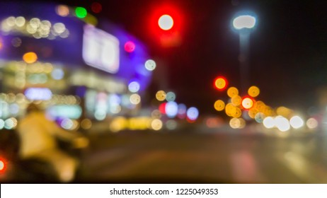 blurred image of the intersection at night with beautiful bokeh in the city