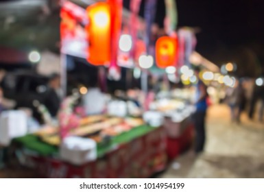 blurred image of japanese food shop in the night street food market