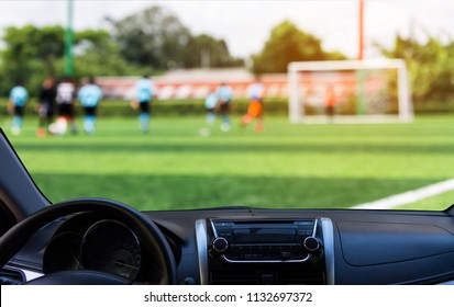 blurred image of kids soccer game look from the front window of the car