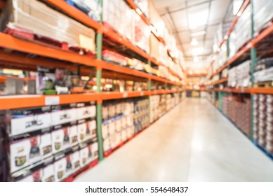 Blurred image large warehouse with row of aisles and shelves from floor to ceiling with bin number. Defocused background of industrial distribution interior aisle, inventory, hypermarket, wholesale.
