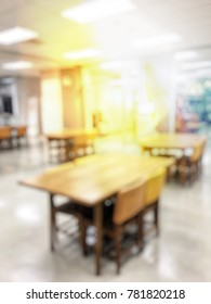 Blurred image of library room, study room with book shelves for education, learning centre where knowledge sharing. Vintage color filter and sun light, background design. no people.