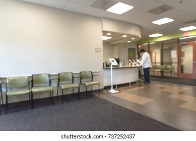Blurred image lobby/front desk area of clinical laboratory services office. Customer check-in on kiosk tablet upon arrival. Test center for diagnostic testing, medical, healthcare abstract background