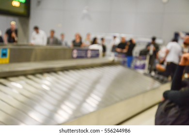 Blurred image of luggage carousel at baggage claim in airport
