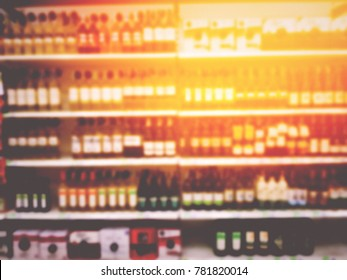Blurred image of many brands of Bottle alcohol beverages.Place on the shelves. in the supermarket. Drinks that people buy to celebrate in the party. Do not sell to children.for background usage.