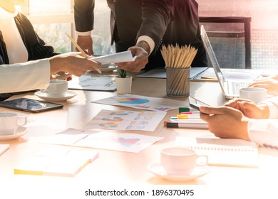 blurred image of meeting business people planning strategy analysis from financial document report during meeting consult, office concept