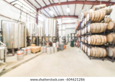Blurred Image Modern Beer Plant (brewery) With Stainless Steel Brewing  Equipments And Stack Of