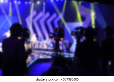 blurred image of multi video camera man shooting a TV programs in studio for background