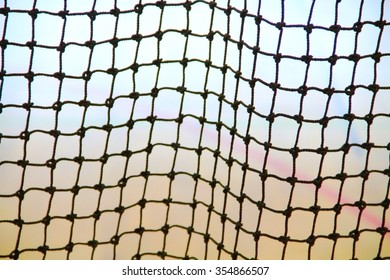 Blurred image of nylon nets at gymnasium, close up.