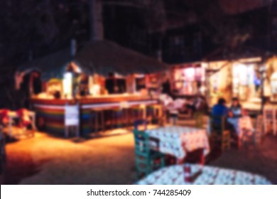 Blurred image of an open air outdoor night bar at tropical island
