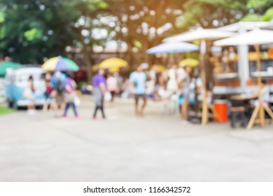 blurred image of outdoor market with coffee van and street foods shop