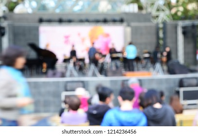 Blurred image of outdoor music event