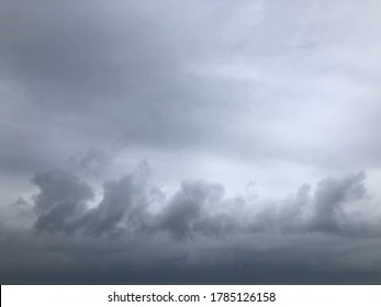 Blurred image overcast sky atmosphere before to be raining. Dark rainy cloudy shape are similar dragon on sky. Natural season change sky. Muggy cloudy sky. Unfocusing shot.