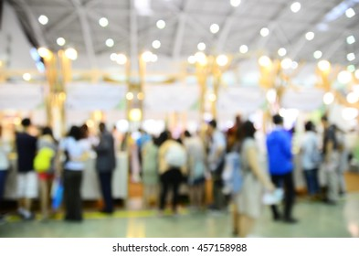 Blurred image of people buying/ shopping in a trade exhibition