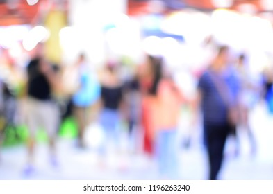 Blurred image of people in commercial activity