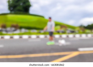 Blurred image of people exercising in the park.