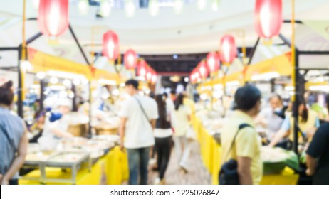 blurred image of people and food shops in the vegetarian festival in Thailand