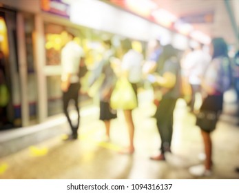 blurred image of people going to work on the queue line or queuing in rush hour in the morning waiting for train subway station. Stay in the crowd cause stress in everyday life. Transport concept.